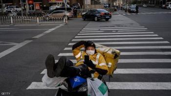 بكين تبحث عن فيروس كورونا وسط الأطعمة والطرود