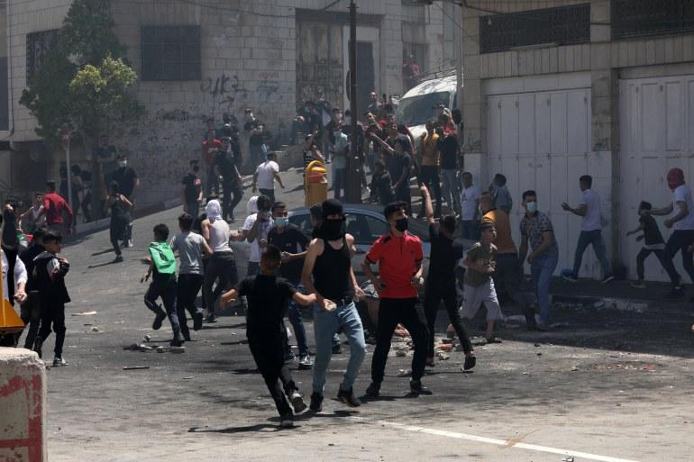 اصابة 25 فلسطينيا في مواجهات مع الاحتلال في الخليل