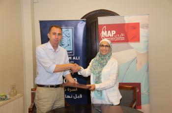 اتفاقية تعاون بين الجمعية الأردنية وتكية أم علي