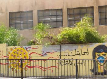جدارية للتوعية بمخاطر كورونا في المقابلين
