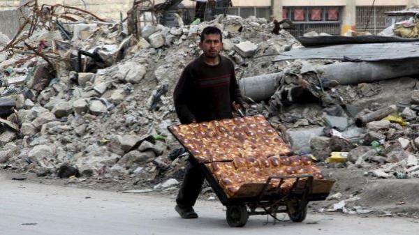 بائع كعك في حلب المدمرة