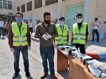 متطوعو كلنا الأردن يشاركون بتنظيم طلبة التوجيهي