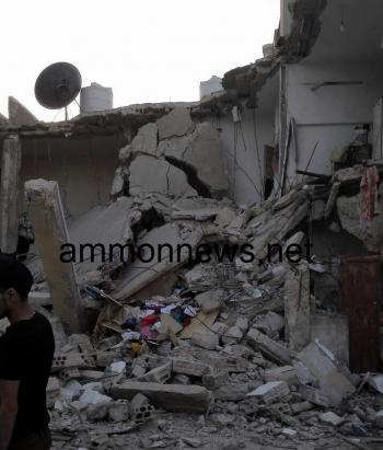 اصابة سوري بانهيار جزئي لعمارة في الزرقاء (صور)