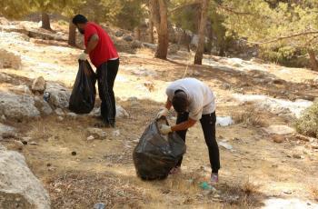 زراعة وادي السير تنفذ حملة نظافة في الغابات والمناطق الحرجية
