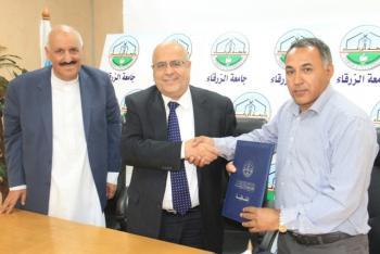 اتفاقية بين جامعة الزرقاء والشركة الوطنية لصيانه السيارات الكهربائية