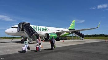 يواجه السجن ..  إندونيسي ركب الطائرة متنكرا في صورة زوجته