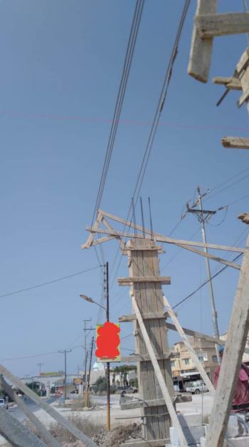 وقف اعتداء بناء متشابك مع خطوط الكهرباء في اربد