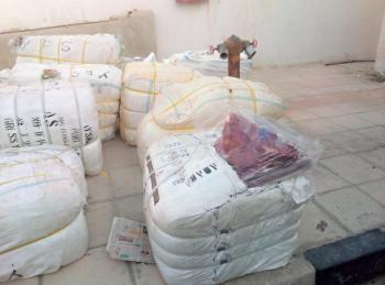 ضبط 15 ألف قطعة ملابس مهربة في عمان