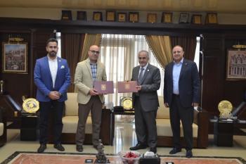 تعاون علمي بين عمان الأهلية وجامعة الحواش الخاصة