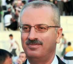 عباس يكلف الاكاديمي رامي الحمد 201363057RN652.jpeg
